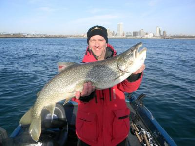Milwaukee Harbor, WI Captain Doug Kloet with giant lake trout March 2012