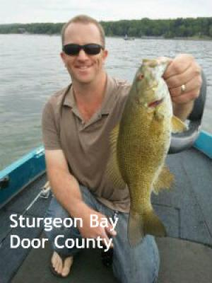 Sturgeon Bay Door county Wisconsin Captain Doug Kloet with nice smallmouth bass May 2012
